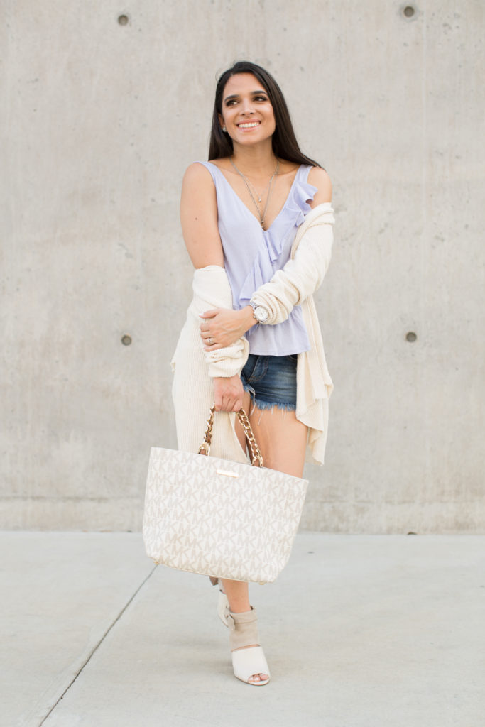 ruffled lilac top, fall outfit, fall sweaters, ruffle sweater, dark denim shorts, leather booties, fall style