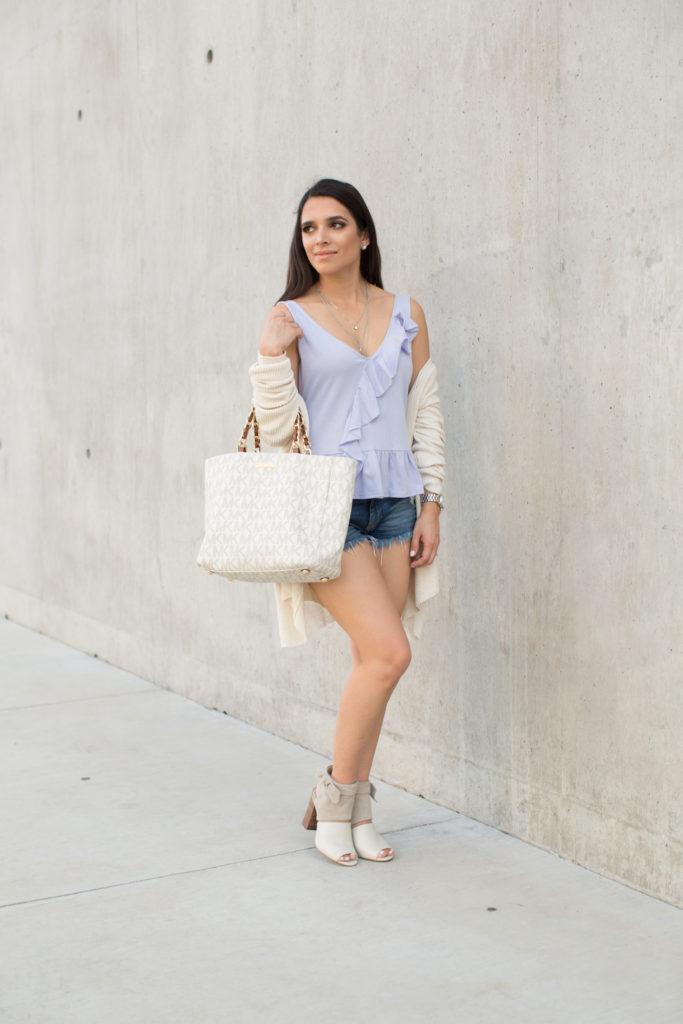 ruffle sweater, fall style, fall outfit, shorts in fall, ruffled cami, ruffle top, booties, michael kors bag, designer bag, statement bag, peep toe booties