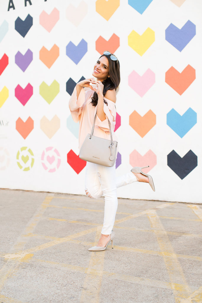 liketoknow.it wall dallas, rewardstyle wall in dallas, heart wall dallas, hearts wall dallas, hearts mural dallas, like to know it dallas, ruffle blouse, white distressed pants, michael kors grey bag, michael kors grey tote, sam edelman pointed pumps grey, sam edelman pointed pumps gray, pointed pumps grey, pointed pumps gray, fall trendy style, fall trendy outfit, ideas for fall outfit, blush long sleeve off shoulder top, blush long sleeve off shoulder blouse, heart mural dallas
